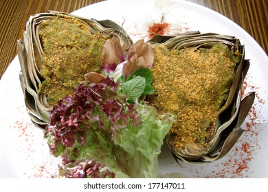 Stuffed artichoke with Lollo rosso salad leaves