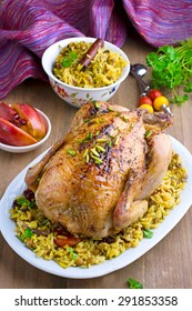 The stuffed baked chicken with rice and dried fruits