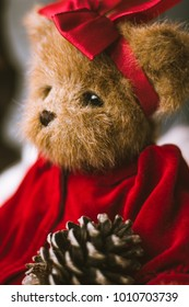 Stuffed bear in fluffy fur with red dress. Valentines day background.