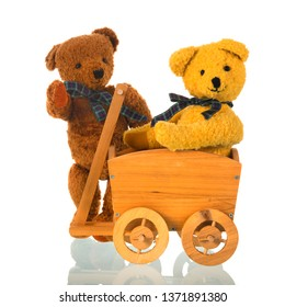 Stuffed bear toys with wooden cart isolated over white background