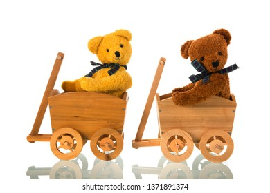 Stuffed bears toys in wooden carts isolated over white background
