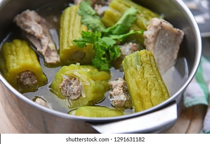 Stuffed Bitter gourd or Bitter cucumber with seasoned minced pork soup in pot  (Thai name is Gang Jeud Mara Sai Moo)
