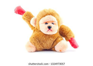 Stuffed brown monkey doll isolated on white background.