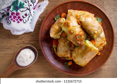 Stuffed cabbage leaves with meat, rice and vegetables. Chou farci, dolma, sarma, sarmale, golubtsy or golabki - popular dish in many countries. overhead, horizontal