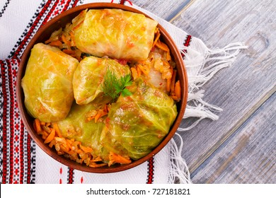 Stuffed cabbage leaves with meat. Cabbage rolls with meat, rice and vegetables. Dolma, sarma, sarmale, golubtsy or golabki. View from above, top, horizontal