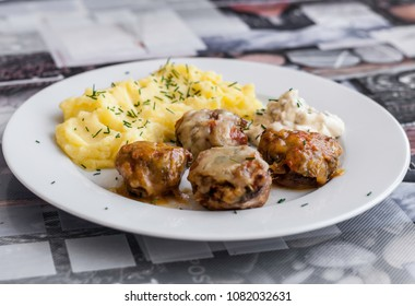 Stuffed champignon with potato pure and homemade tartar sauce