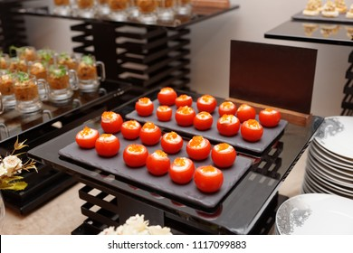 Stuffed cherry tomatoes on banquet table, catering event