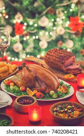 Stuffed Christmas turkey dinner served in front of a Christmas tree