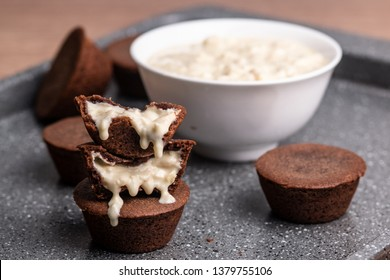 Stuffed coconut cream cookie cups baked in a muffin pan. Set of homemade creamy filling chocolate cookies. Sweet and delicious pastry. Creative dessert. - Image