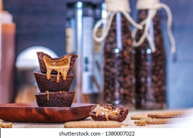 Stuffed crunchy cream cookie cups baked in a muffin tin. Homemade caramel filling chocolate cookies on wooden plate. Sweet and delicious pastry. Creative dessert. - Image