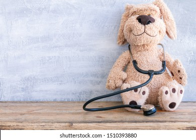 Stuffed Dog animal presented as a pediatrician holding a stethoscope with copy space