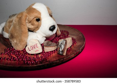 Stuffed dog with a sweet heart and red background