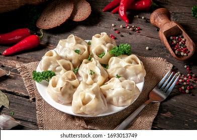 Stuffed dumplings, manti of dough and minced, close up