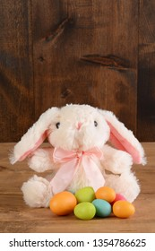 stuffed easter bunny with colorful eggs