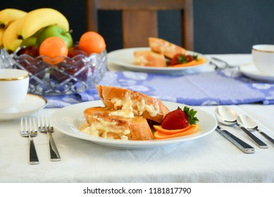 Stuffed French Toast on a breakfast table with fresh fruit.