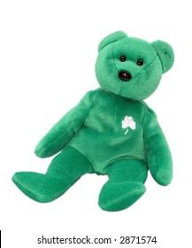 Stuffed green irish teddy bear over white.
