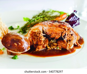 Stuffed meat and mushrooms prepared with a special presentation.