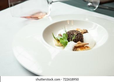 stuffed morels under truffle sauce