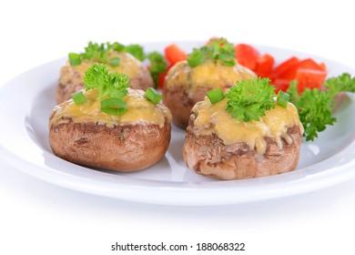 Stuffed mushrooms on plate isolated on white