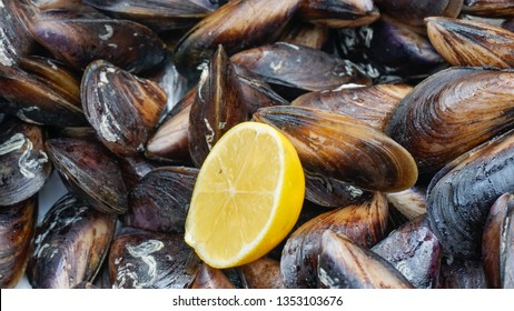 """Stuffed mussel at seaside in Konak (Alsancak), Izmir. Popular traditional raw fresh food as known in native language """"Midye Dolma"""".  Snack nutrition concept background."""