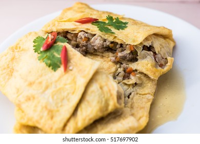 stuffed omelette, Omelet with vegetable salad and chilli, stuffed omelette on white plate.