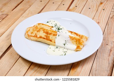 stuffed pancakes with sour cream