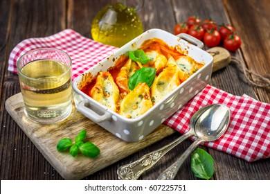 Stuffed pasta shells casserole with gorgonzola, ricotta and tomato sauce