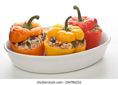 stuffed peppers in a dish on white background