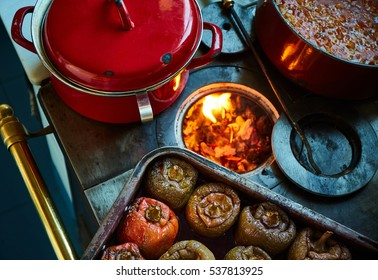 stuffed peppers over an old coal kitchen full of fire and other stews