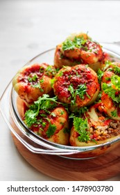 Stuffed peppers with rice, lentils and vegetables cooked with tomato sauce in oven in glass tray