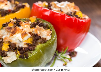 Stuffed Peppers (with Meat, Herbs and Cheese) on wooden background