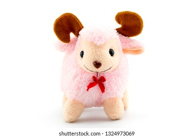 Stuffed pink sheep doll isolated on white background.