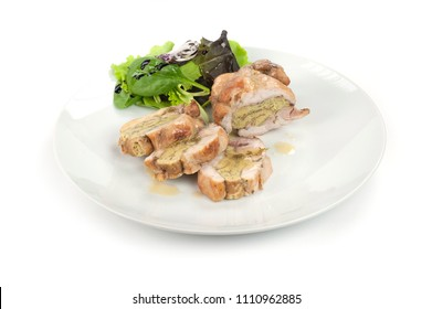 stuffed rabbit served sliced ??with salad