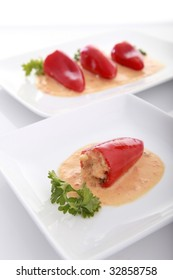Stuffed red bell peppers and creamy sauce