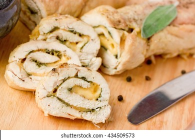 Stuffed roll of chicken with cheese and sage selective focus