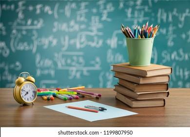 A stuffed school desk with green blackboard