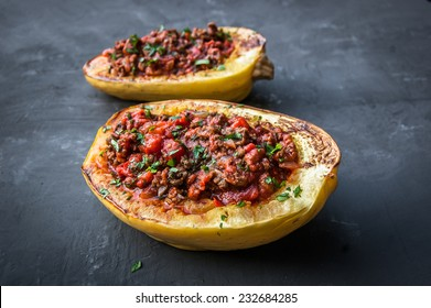 Stuffed Spaghetti squash with ground beef tomatoes and seasoning. Topped with parsley