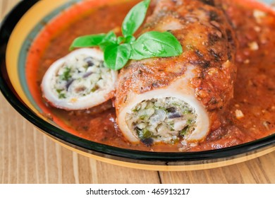Stuffed squid with parmesan cheese, onion and parsley in tomato sauce.