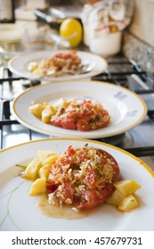 stuffed tomatoes with rice accompanied by baked potatoes
