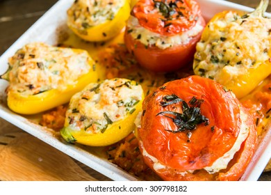 Stuffed tomatoes, zucchini and bell pepper baked in the oven. Vegetables are in the ceramic dish. Above view