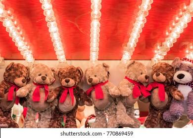 Stuffed toy bears on display awarded as winning prizes at Christmas funfair winter wonderland of London