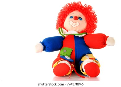stuffed toy clown sitting on a table