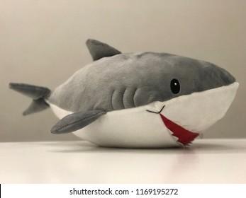 Stuffed toy shark.