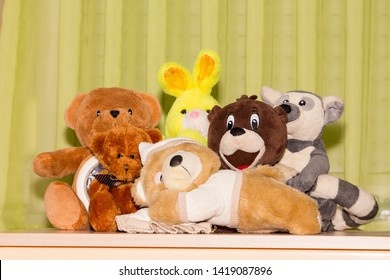 Stuffed toys on a desk. All looking to camera