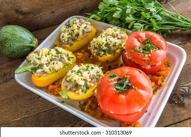 Stuffed vegetables before baking on wooden background. Above view