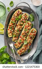 Stuffed zucchini boats with vegetables and cheese,  top view