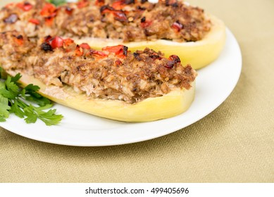 Stuffed zucchini with mixture of vegetables, meat, cheese and herbs. Traditionally baked squash filled with minced meat, cooked rice, onions, garlic, spices, covered with red paprika,cheese. Closeup.