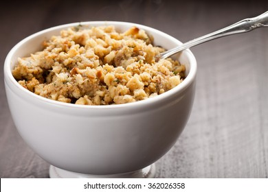 Stuffing in a white bowl on wood background