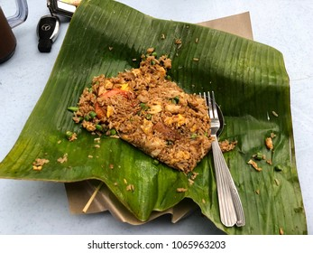 Stulang Laut, Johor - 8 April 2018 : Modern fishing restorant was served delicious Nasi Goreng special and it wrapped by banana leaf.