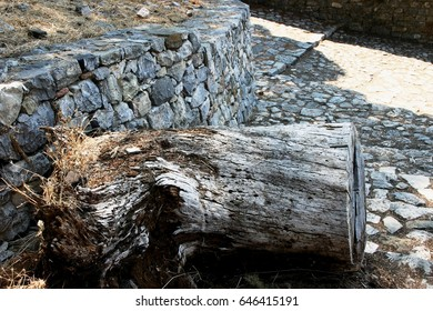Stump, stones, stone wall and street of the fortress